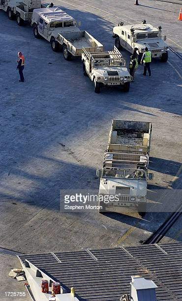 A row of US Army Humvees wait to be loaded from the dock January 14 2003 at the Port of Savannah Georgia The vehicles were being loaded aboard the...