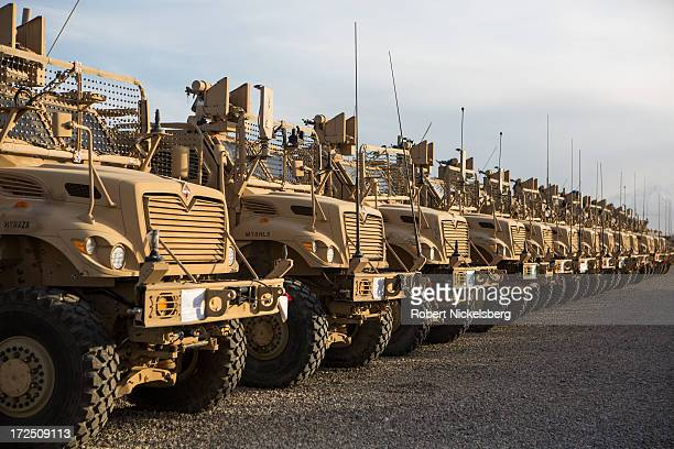 Row of U.S. Army MRAP vehicles can be seen lined up May 9, 2013 at Bagram Air Base, Afghanistan. The vehicles will be sent to other bases inside...