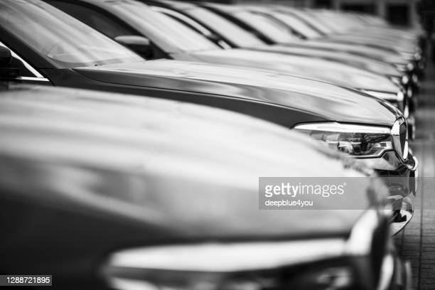 a row of used bmw cars parked at a public car dealership in hamburg, germany - brand name stock pictures, royalty-free photos & images