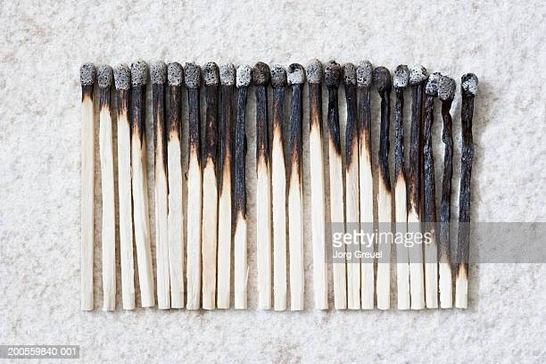 Row of used matches on stone surface, close up