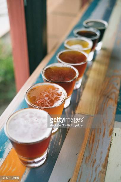 Row Of Various Beer Glasses On Table