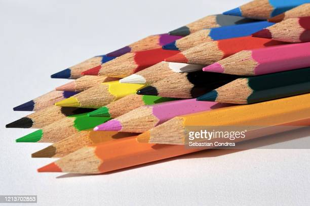 row of various coloring pencils, on a white background. standing out from the crowd concept. isolated on white, clipping path included. - planning stock pictures, royalty-free photos & images