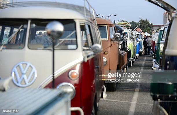 A row of Volkswagen's iconic Kombi buses are displayed at 'Das OCTO Fest 2013' a swap and display gathering for enthusiasts and owners of 1967 and...