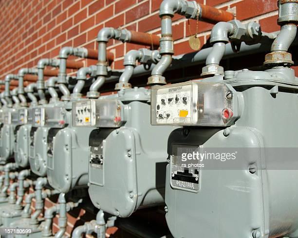 Row of water meters on brick wall