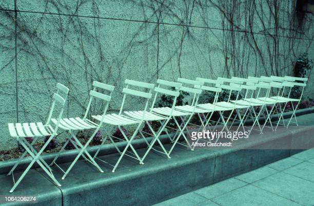 A row of white garden chairs US 1988