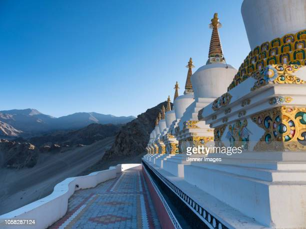 A row of white stupas at Thiksey Monastery in Ladakh.