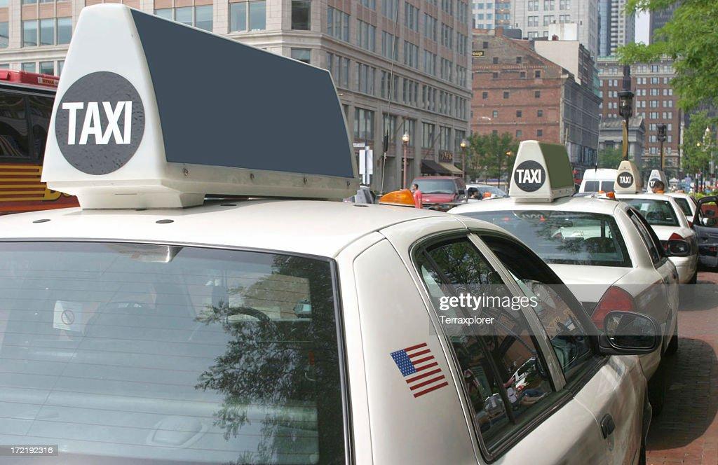Row of White Taxis : Stock Photo