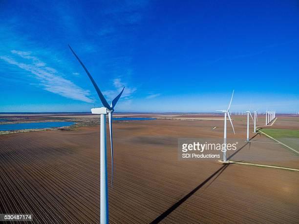 Row of wind turbines against blue sky