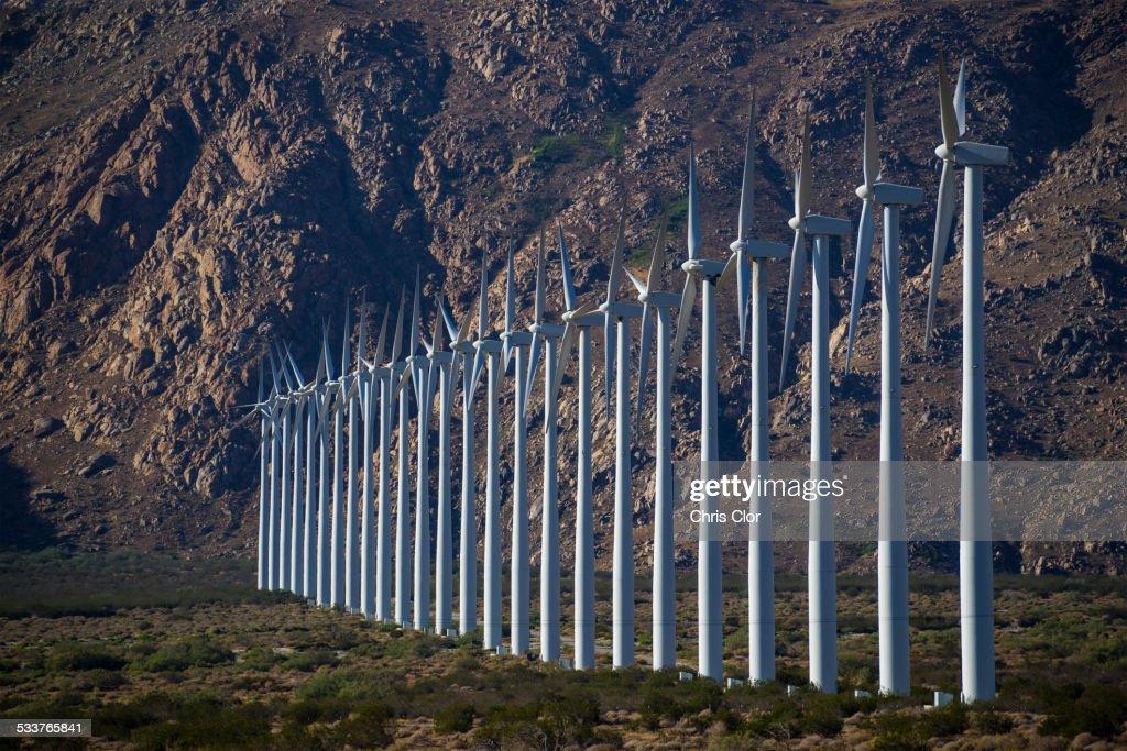 Row of wind turbines in rocky remote landscape : Foto stock