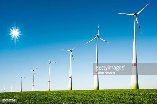 Row of wind turbines in wind farm, Bavaria, Germany