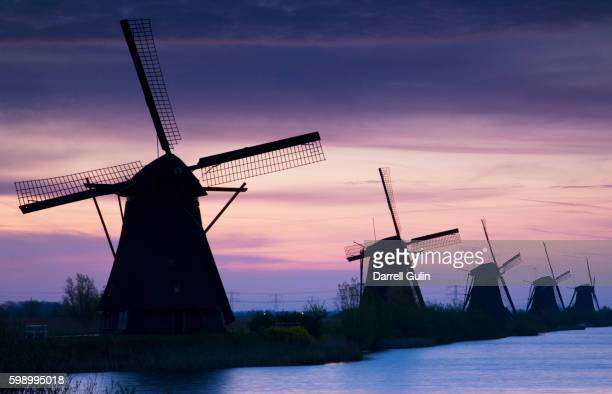 Row of windmills at sunrise in the Netherlands