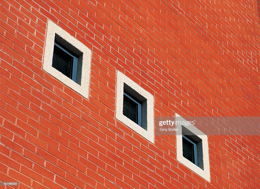 Row of windows on brick wall : Stock Photo