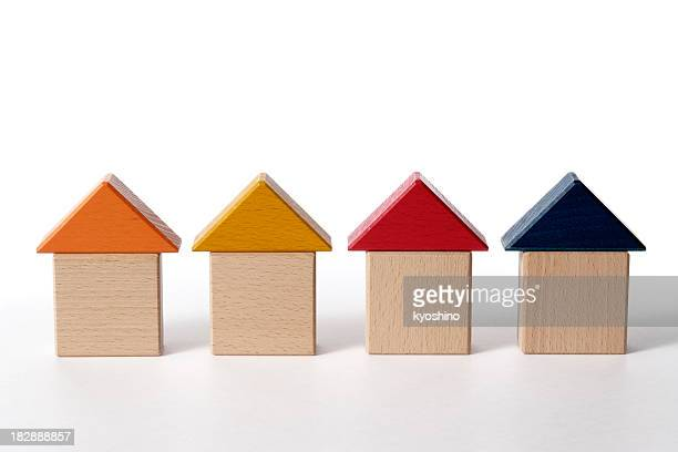 Row of wood block houses on white background