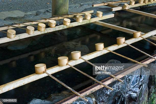 row of wooden scoops on tsukubai at ise shrine, ise, mie, japan - ise mie stock pictures, royalty-free photos & images