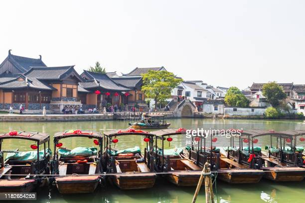row of wooden tourboats moored at wharf ,jinxi ancient town of kunshan - suzhou stock pictures, royalty-free photos & images