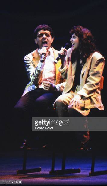 Rowan Atkinson and Kate Bush sing a duet at Comic Relief Live, a live comedy show presented on the evenings of 4th, 5th & 6th of April 1986 at the...