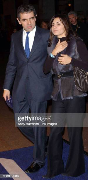 Rowan Atkinson arrives with his wife Sunetra for the DVD screening of A Concert For George at Odeon West End in central London The DVD features a...