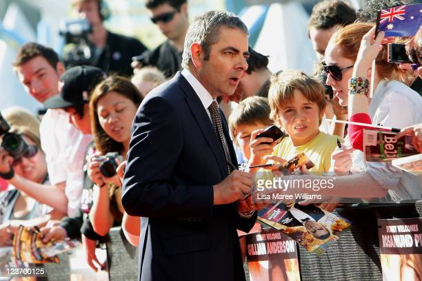 """Rowan Atkinson greets fans at the """"Johnny English Reborn"""" world premiere at The Entertainment Quarter on September 4, 2011 in Sydney, Australia."""