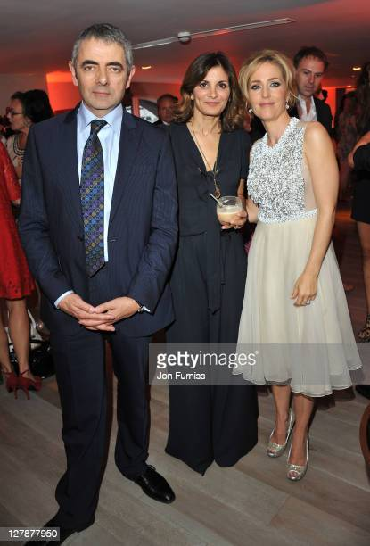 Rowan Atkinson Sunetra Sastry and Gillian Anderson attend the 'Johnny English Reborn' UK premiere after party at Senkai on October 2 2011 in London...