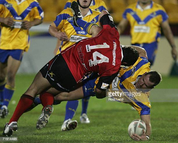 Rowan Baxter of the Lions tackled by Clinton Fraser during the NZRL National Premiership Bartercard Cup Grand Final league match between the Auckland...
