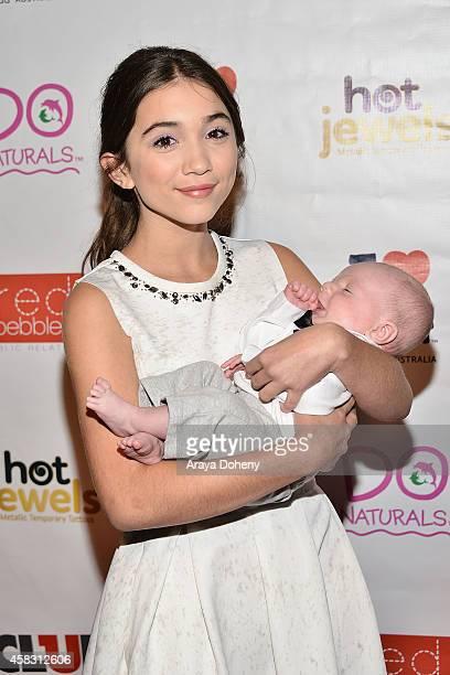 Rowan Blanchard holding publicist Kimber Hamill's son celebrates her 13th Birthday on November 2 2014 in Los Angeles California