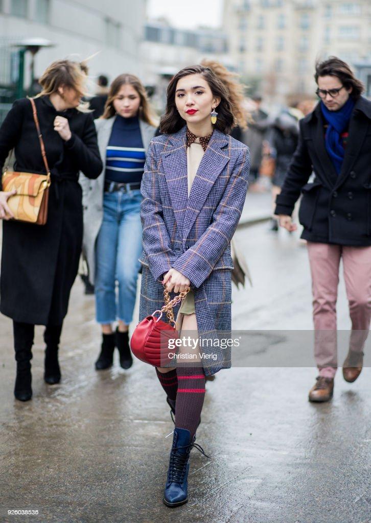 Rowan Blanchard wearing a plaid coat, Chloe bag, knee socks is seen outside Chloe on March 1, 2018 in Paris, France.