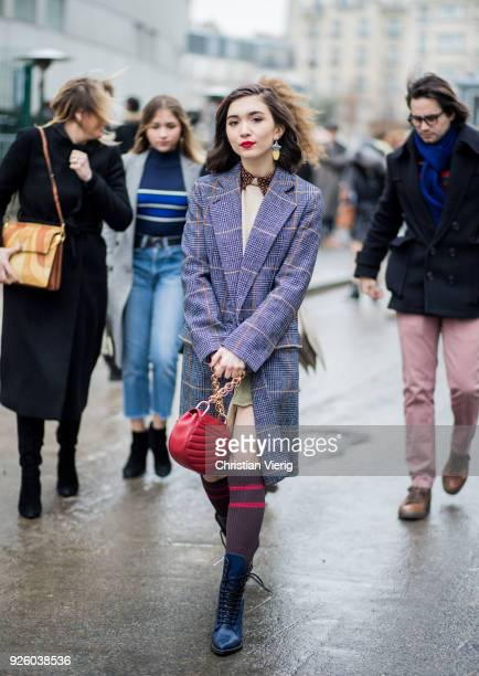 Rowan Blanchard wearing a plaid coat Chloe bag knee socks is seen outside Chloe on March 1 2018 in Paris France