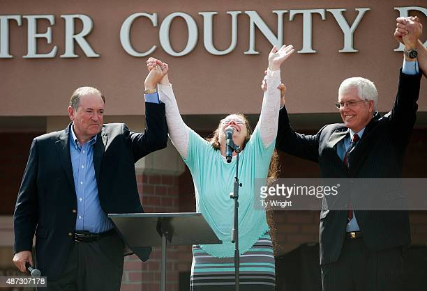 Rowan County Clerk of Courts Kim Davis holds her hands in the air with her attorney Mat Staver and Republican presidential candidate Mike Huckabee in...