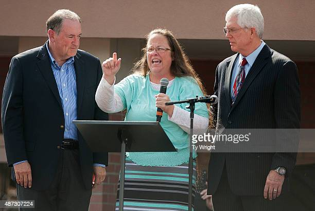 Rowan County Clerk of Courts Kim Davis speaks next to her attorney Mat Staver and Republican presidential candidate Mike Huckabee in front of the...