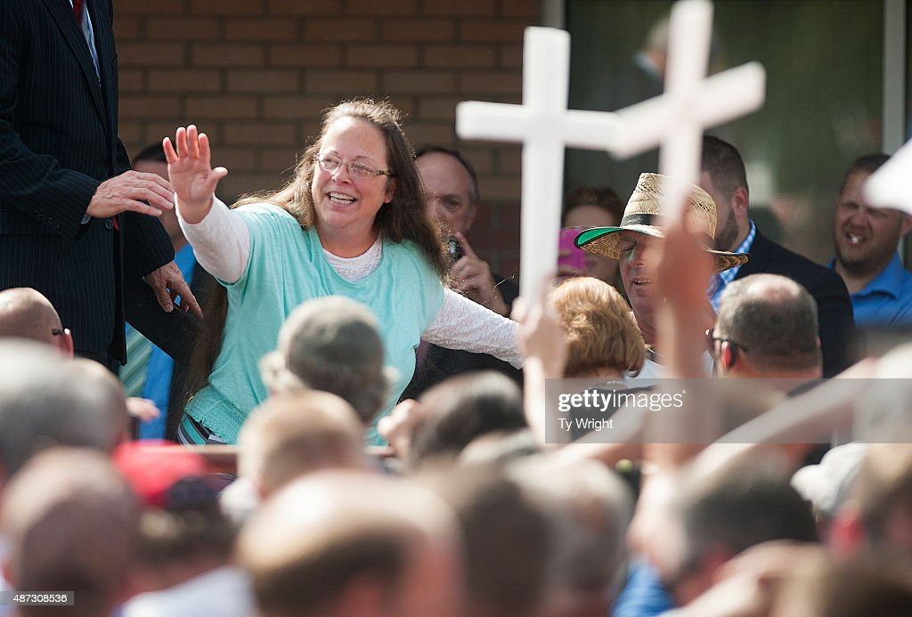 Rowan County Clerk of Courts Kim Davis waves to a crowd of her supporters at a rally in front of the Carter County Detention Center on September 8, 2015 in Grayson, Kentucky. Davis was ordered to jail last week for contempt of court after refusing a court order to issue marriage licenses to same-sex couples.