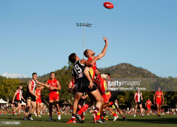 Rowan Marshall of the Saints and Jarrod Witts of the Suns compete in a ruck contest during the 2019 AFL round 13 match between the Gold Coast Suns...
