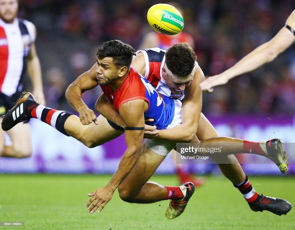 Rowan Marshall of the Saints tackles Neville Jetta of the Demons during the round seven AFL match between St Kilda Saints and the Melbourne Demons at Etihad Stadium on May 6, 2018 in Melbourne, Australia.