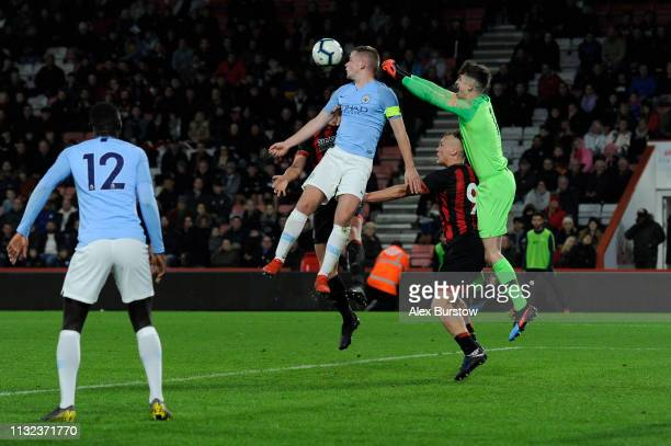 Rowan McDonald and Louie Moulden of Manchester City battle for possession in the air with Jake Scrimshaw of AFC Bournemouth during the FA Youth Cup...