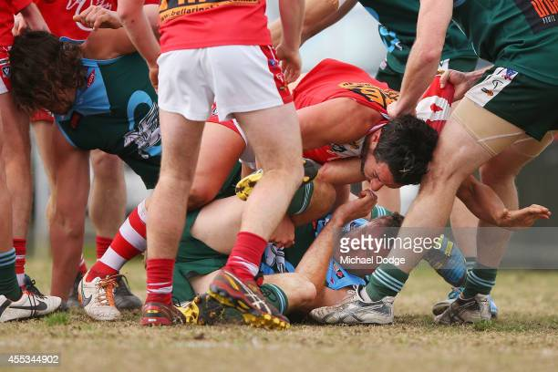Rowan McSparron of Geelong is pinned down in a melee during the Bellarine Football League Grand Final match between Geelong Amateurs and Ocean Grove...