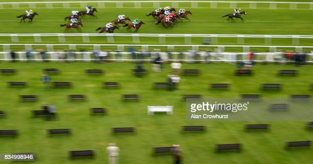 Rowan Scott riding Set In Stone win The Christopher Smith Associates handicap Stakes at Newbury racecourse on August 18 2017 in Newbury England