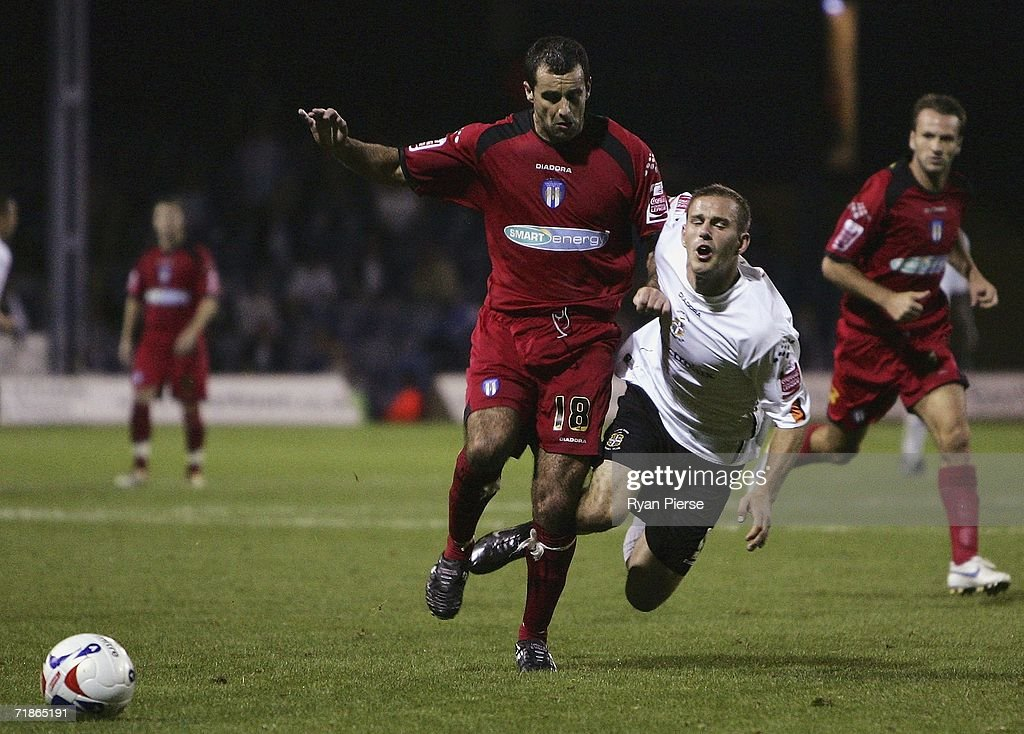 Rowan Vine (R) of Luton is tackled by Chris Barker (L) of Colchester during the Coca Cola Championship match between Luton Town and Colchester United at Kenilworth Road on September 12, 2006 in Luton, England.