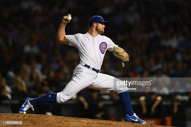Rowan Wick of the Chicago Cubs throws a pitch during the eighth inning against the San Francisco Giants at Wrigley Field on August 20 2019 in Chicago...