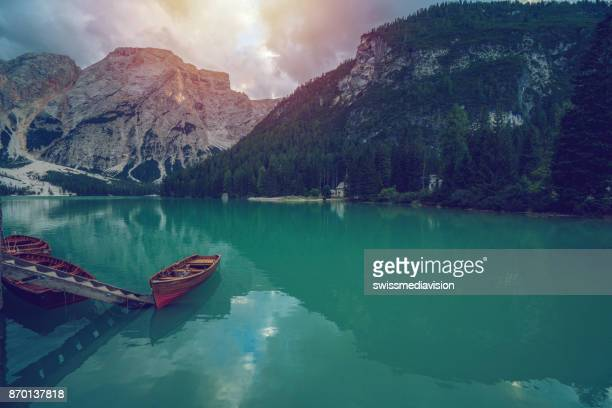 Rowbats floating on lake Braies in Italy