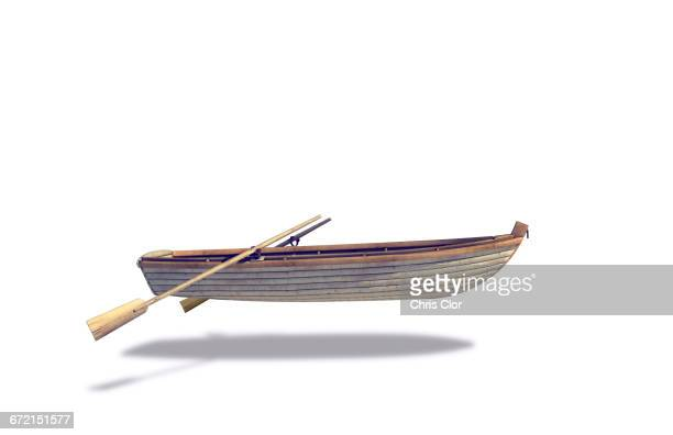 rowboat and oars floating in white background - hovering stock photos and pictures