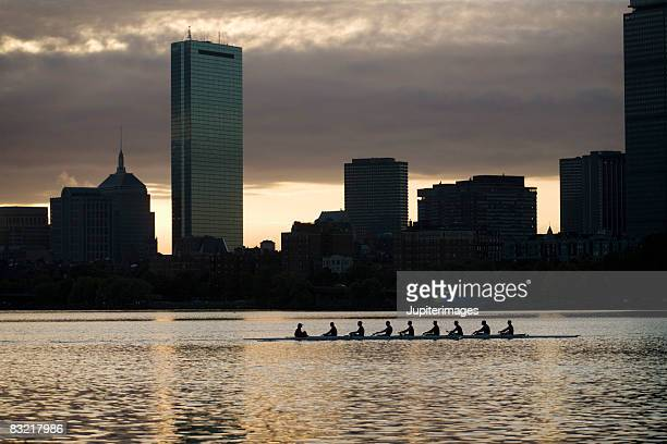 Rowboat by skyline of Boston, Massachusetts