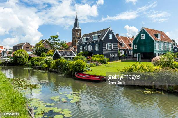rowboat in canal at traditional village - pennsylvania stock pictures, royalty-free photos & images