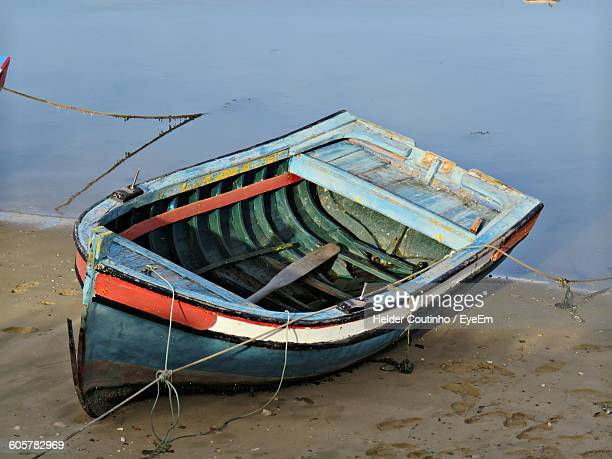 Rowboat Moored On Shore