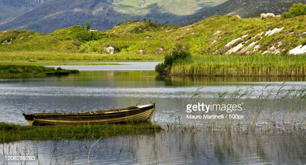 rowboat on lake, ireland - martinelli stock pictures, royalty-free photos & images