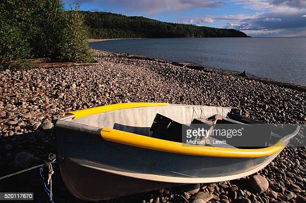 rowboat on shore of gargantua harbour - lake superior provincial park stock pictures, royalty-free photos & images