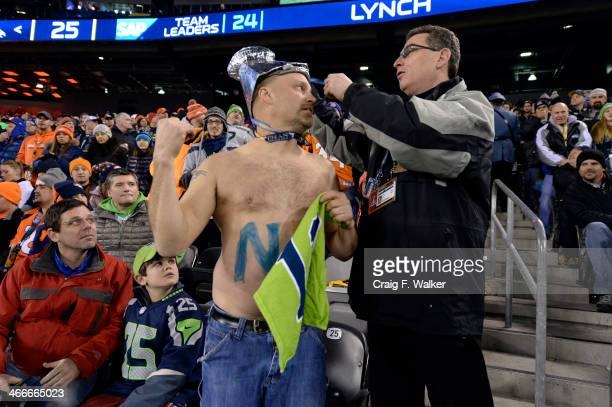 A rowdy Seahawks fan has his tickets checked by officials during the fourth quarter The Denver Broncos vs the Seattle Seahawks in Super Bowl XLVIII...