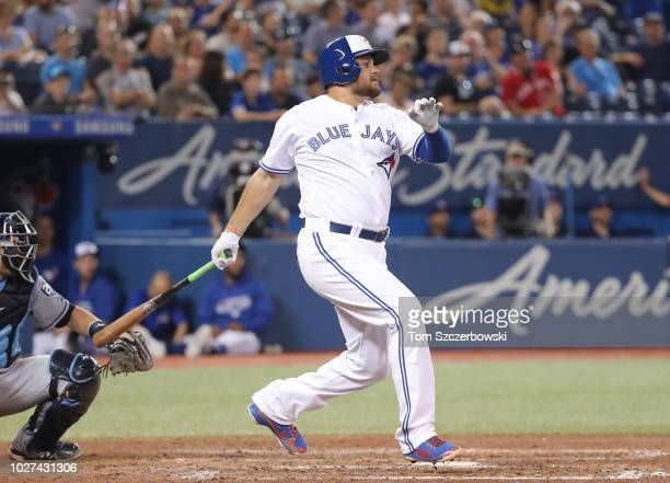 Rowdy Tellez of the Toronto Blue Jays hits an RBI double for his first career MLB hit in the sixth inning during MLB game action against the Tampa...