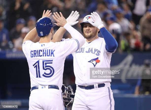 Rowdy Tellez of the Toronto Blue Jays is congratulated by Randal Grichuk after hitting a tworun home run in the second inning during MLB game action...