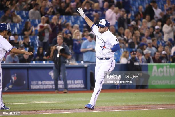 Rowdy Tellez of the Toronto Blue Jays is congratulated by third base coach Luis Rivera after hitting a tworun home run in the second inning during...