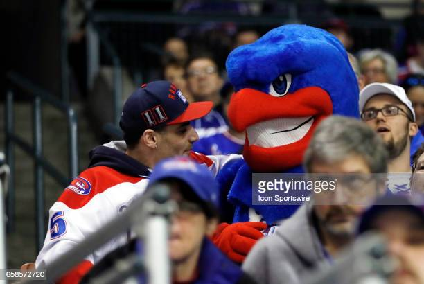 Rowdy the River Hawk hams it up with a fan during the NCAA Northeast Regional final between the UMass Lowell River Hawks and the Notre Dame Fighting...