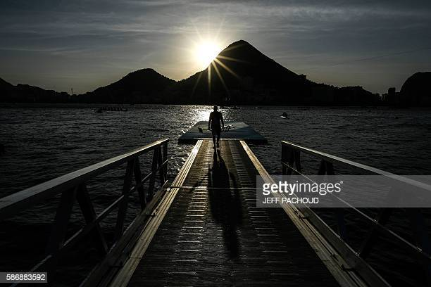 TOPSHOT A rower arrives for a training session before the race at the Lagoa Rodrigo de Freitas in Rio de Janeiro during the Rio 2016 Olympic Games on...